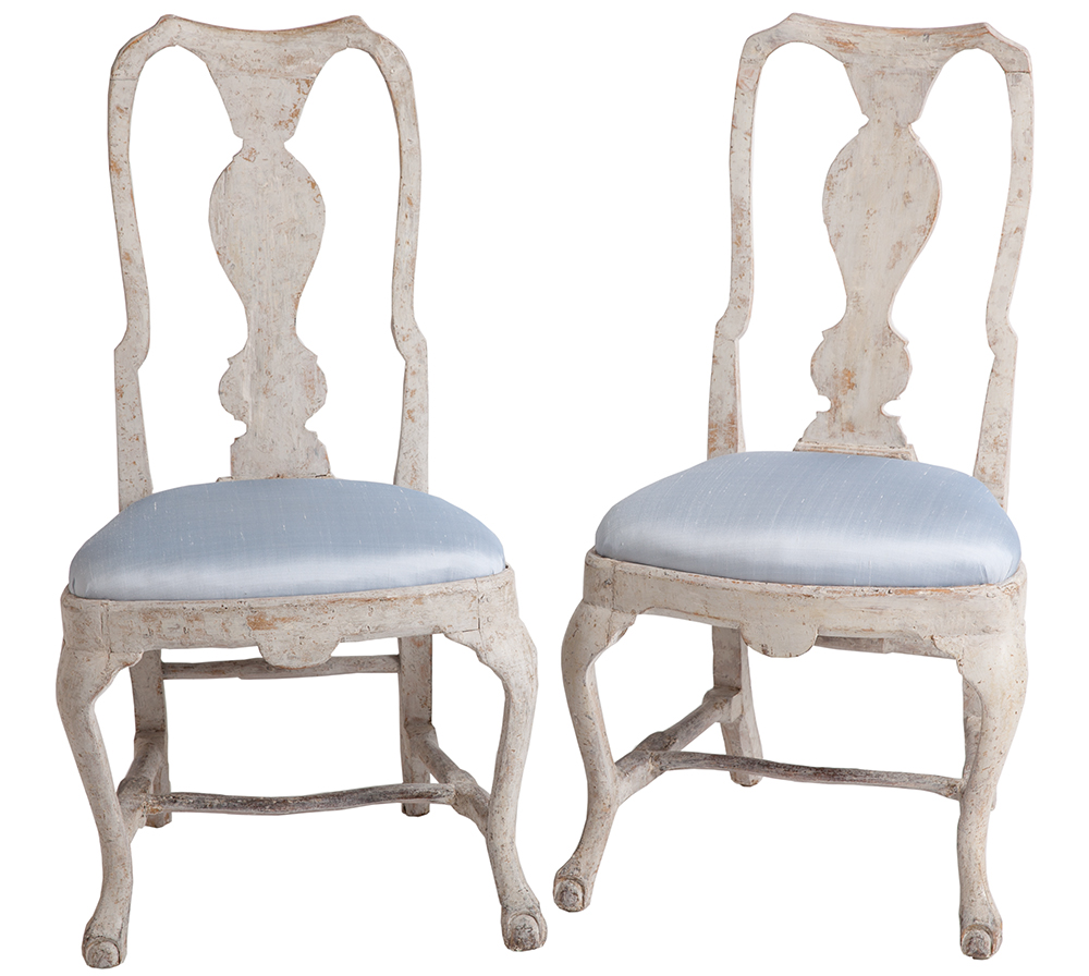pair of antique Swedish, Rococo Side Chairs with carved ball and claw feet on curved wide knee legs